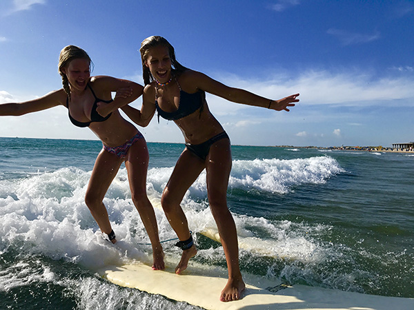 Girls tandem surfing lessons at South Padre Island!